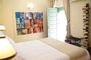 Un ou plusieurs lits dans un hébergement de l'établissement Riad Abracadabra