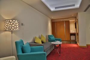 A seating area at Dhaka Regency Hotel & Resort Limited