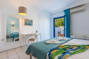 Łóżko lub łóżka w pokoju w obiekcie Hotel Hara Ilios Village