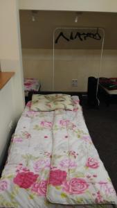 Кровать или кровати в номере Старое Место Хостел