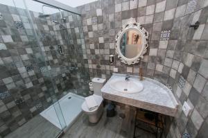 Ванная комната в Hotel Boutique The Cathedral