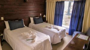 A bed or beds in a room at Lar Aike