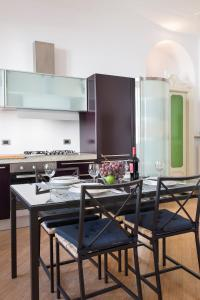 A kitchen or kitchenette at Corso Como Apartment -Charme and Comfort