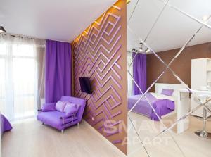 Кровать или кровати в номере Smart Apart