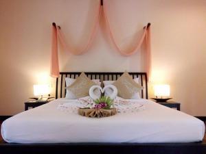 Voodi või voodid majutusasutuse Sudala Beach Resort toas