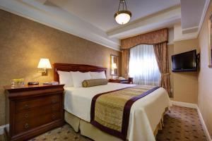 Cama o camas de una habitación en Wellington Hotel