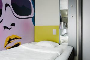 En eller flere senge i et værelse på Comfort Hotel Kristiansand