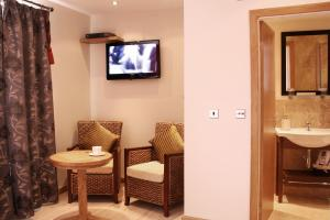 A television and/or entertainment centre at Harrys lounge
