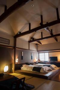 A bed or beds in a room at Naraya