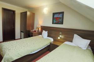 Кровать или кровати в номере Pension Tempo