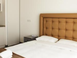 A bed or beds in a room at Apartment Adonis Aix en Provence-1