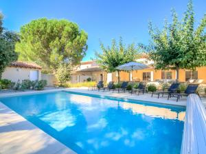 The swimming pool at or near Holiday Home Les Oliviers