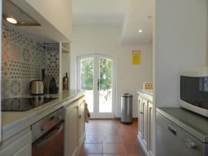 A kitchen or kitchenette at Holiday Home Domaine du Dragon-4
