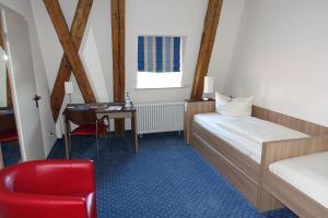 Ein Bett oder Betten in einem Zimmer der Unterkunft Tagungshaus Schönenberg