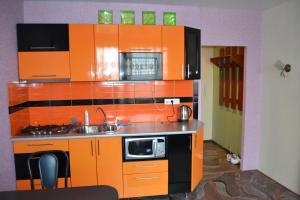 A kitchen or kitchenette at Apartment in Shestoy mikrorayon