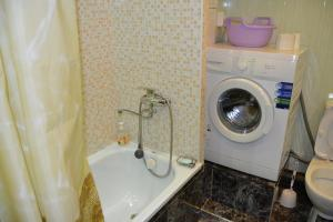 A bathroom at Apartment in Shestoy mikrorayon