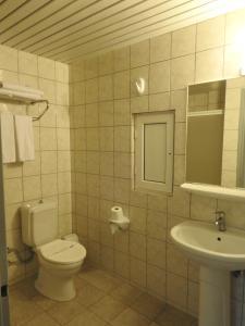 Ein Badezimmer in der Unterkunft Sailor Apart Hotel