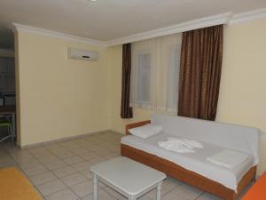 Ein Bett oder Betten in einem Zimmer der Unterkunft Sailor Apart Hotel