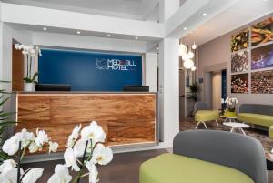 The lobby or reception area at Hotel Medinblu