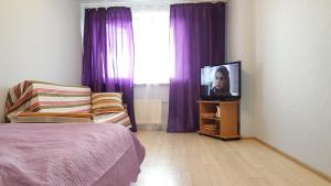 A bed or beds in a room at Apartment on Nosovikhinskoye shosse 27