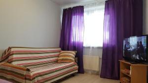A seating area at Apartment on Nosovikhinskoye shosse 27