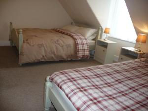 A bed or beds in a room at Aberlour Bolthole