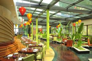A restaurant or other place to eat at Hilton Hanoi Opera
