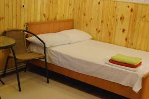 A bed or beds in a room at Cottages On Gdantsevskaya Street