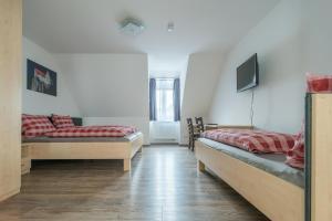 Ein Bett oder Betten in einem Zimmer der Unterkunft Anitas Altstadtpension