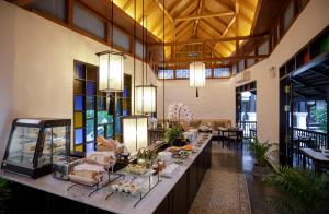 A restaurant or other place to eat at Thai Akara - Lanna Boutique Hotel