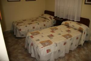 A bed or beds in a room at Casa Modesto