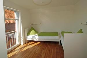 Ein Bett oder Betten in einem Zimmer der Unterkunft Ferienhof Altes Land