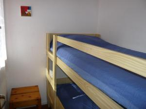 A bunk bed or bunk beds in a room at Holiday Home Les Palombes-1