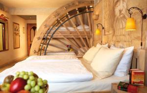 מיטה או מיטות בחדר ב-4-Sterne Superior Erlebnishotel Colosseo, Europa-Park Freizeitpark & Erlebnis-Resort