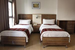 Cama o camas de una habitación en Afnan Hotel