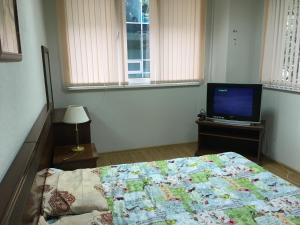 Кровать или кровати в номере Новый Хостел Сочи