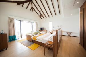 Ein Bett oder Betten in einem Zimmer der Unterkunft Robinson Club Noonu - All Inclusive