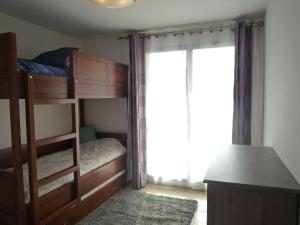 A bunk bed or bunk beds in a room at Apartment Blue Bay