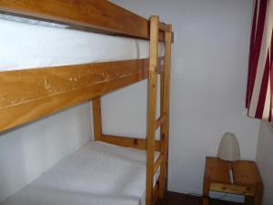A bunk bed or bunk beds in a room at Holiday Home Les Palombes-3