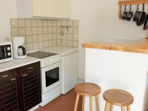 A kitchen or kitchenette at Holiday Home Les Palombes-7