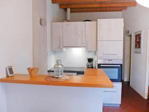 A kitchen or kitchenette at Holiday Home Les Palombes-3