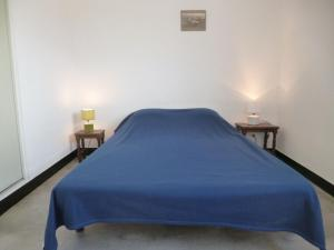 A bed or beds in a room at Apartment Soleil Levant 1 et 2-2