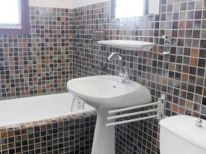A bathroom at Holiday Home St André de la Roche