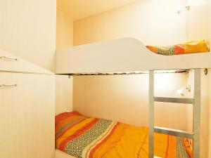 A bunk bed or bunk beds in a room at Apartment la vanoise-1