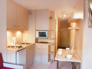 A kitchen or kitchenette at Apartment la vanoise-1