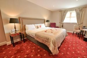 A bed or beds in a room at Ballyliffin TownHouse Boutique Hotel