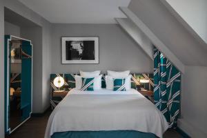 Un ou plusieurs lits dans un hébergement de l'établissement Hôtel Louvre Piemont