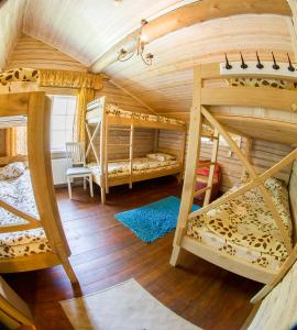 Dviaukštė lova arba lovos apgyvendinimo įstaigoje Sodyba Pas Rapola