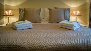 A bed or beds in a room at The Flintshire