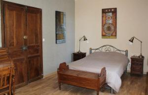 Un ou plusieurs lits dans un hébergement de l'établissement Les Chambres du Clos des Capucins